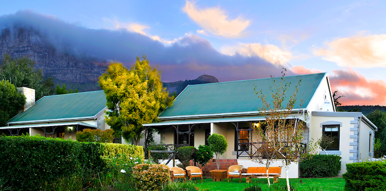 The suites of Angala Boutique Hotel sit high on the slopes on Simonsberg with an impressive mountainous backdrop