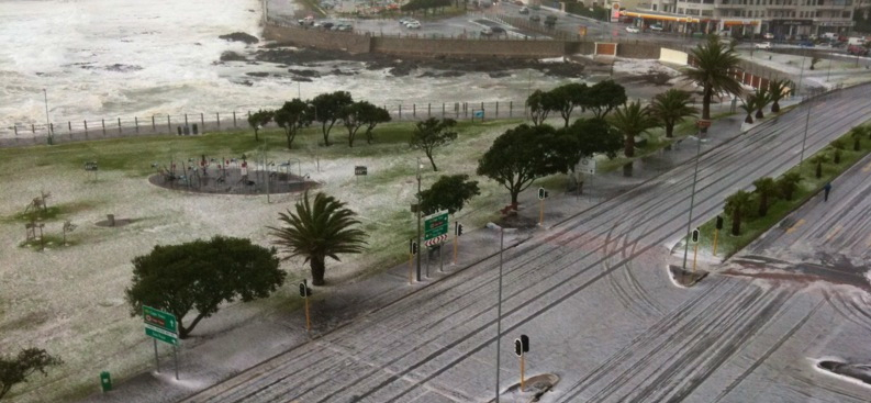 A thunderous five-minute hail storm turns the Sea Point Promenade snow-white