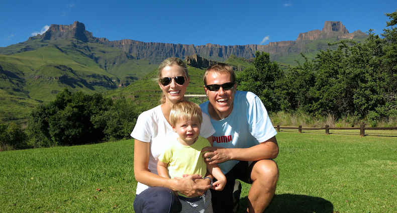 A happy family poses below the giant amphitheatre of Royal Natal National Park and World Heritage Site