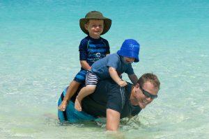 Boys riding a seahorse