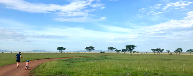 Sunday morning runs with the boys on their bikes enjoying the wide-open Serengeti plains